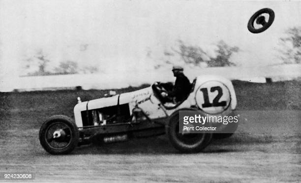 American Speedway Racing Jack Ericson of New Jersey making a successful turn on three wheels His front wheel can be seen flying in the opposite...