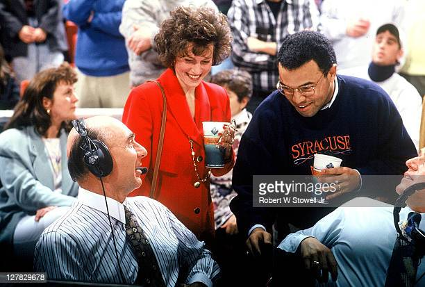 American sports journalist Dick Vitale talks with fellow ESPN commentator Mike Tirico before a basketball game, Hartford, Connecticut, 1992.