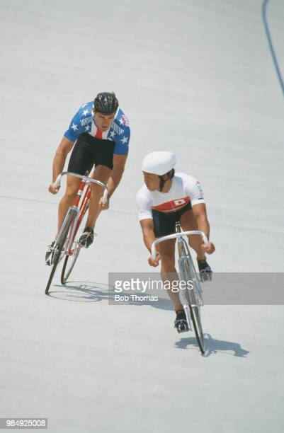 American sprint cyclist Mark Gorski of the United States team pictured on left in action competing against Tsutomu Sakamoto of Japan in heat 1of the...