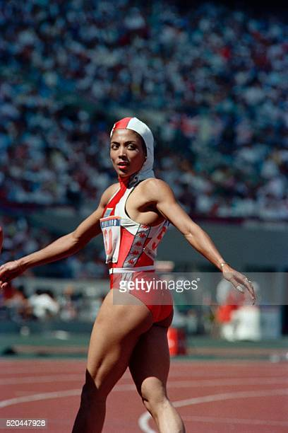 American sprint star Florence GriffithJoyner looks back after the Women's 100 m semifinal at Seoul Olympic Stadium on September 24 1988 The American...