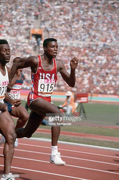 American sprinter Carl Lewis competes in a sprint competition at the 1984 Summer Olympics in Los Angeles Lewis would go on to win four gold medal in...