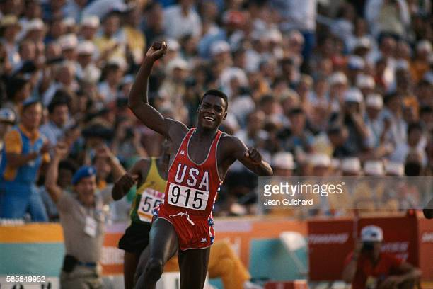 American sprinter Carl Lewis competes in a sprint competition at the 1984 Summer Olympics in Los Angeles Lewis would go on to win four gold medals in...