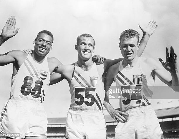 American sprinters Bobby Morrow , Andy Stanfield , and Thane Baker embrace after sweeping the men's 200-meter dash at the 1956 Summer Olympics at...