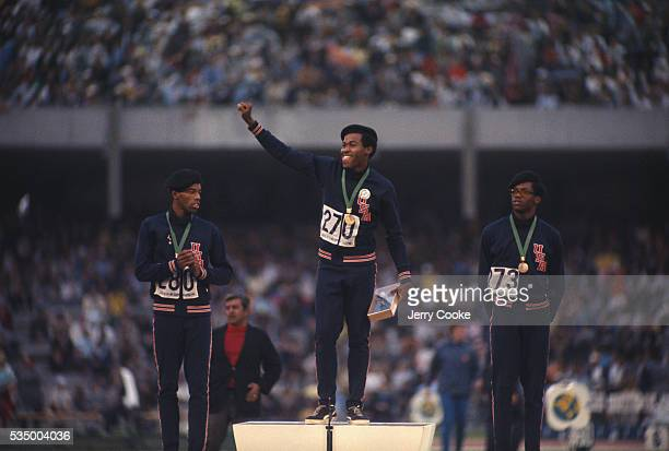 American sprinters Larry James, Lee Evans and Ronald Freeman III stand on the winner's podium at the 1968 Olympic games in Mexico City. The three men...