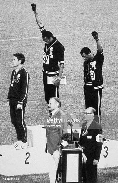 American sprinters Tommie Smith and John Carlos raise their fists and give the Black Power Salute at the 1968 Olympic Games in Mexico City The move...