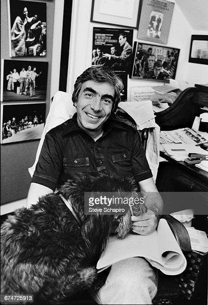 American stage and film director Gordon Davidson in his home office with his dog Pacific Palisades Los Angeles California 1980