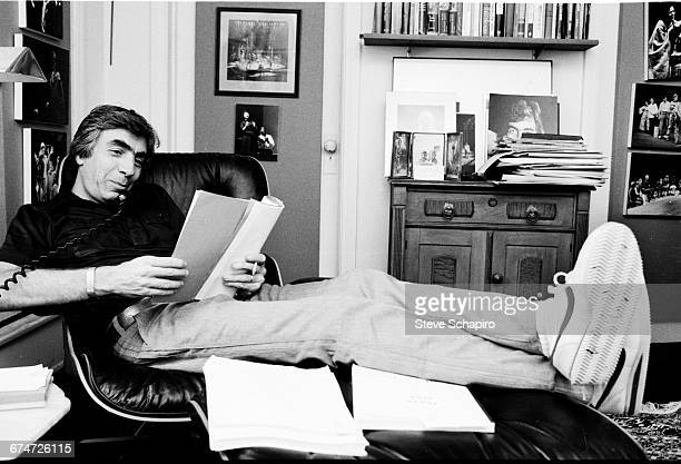 American stage and film director Gordon Davidson reading a script in his home office Pacific Palisades Los Angeles California 1980