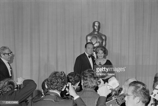 American standup comedian performer and author Bob Hope with American comic actress and singer Martha Raye winner of the 'Jean Hersholt Humanitarian...