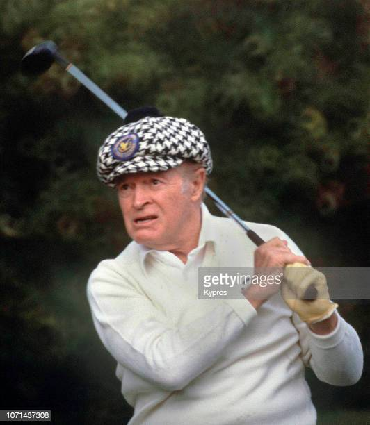 American stand-up comedian, vaudevillian, actor, singer, athlete, and author Bob Hope playing golf, circa 1990.