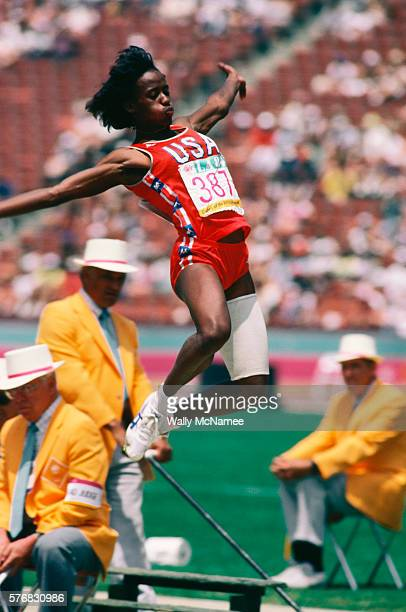 American star heptathelete Jackie Joyner flies through the air in the long jump segment of the heptathlon event in Los Angeles CA on August 4 1984...