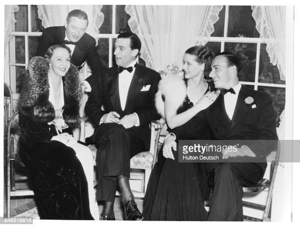 American stars Rita Kauffman Edmund Lowe Walter Pidgeon Mary Howard and Lloyd Pontages at a dinner at Raul Walsh's home ca 1935