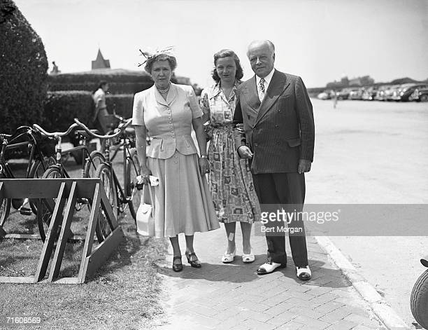 American stockbroker James F McDonnell stands with his wife Anna Murray McDonnell and daughter Barbara by a bicycle rack near the entrance of the...