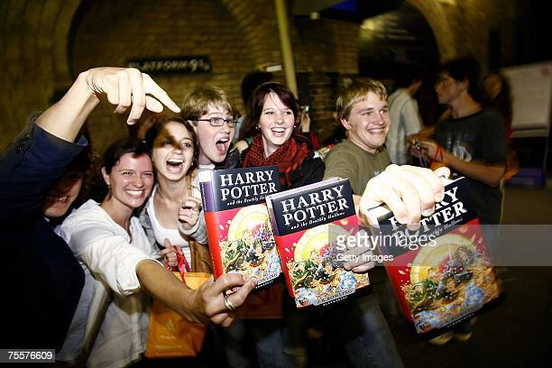 American students celebrate the release of the latest and final book by author JK Rowling Harry Potter and the Deathly Hallows in Kings Cross Train...