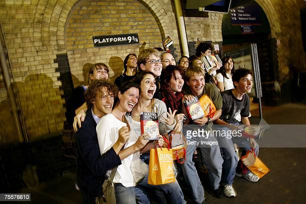 American students celebrate the release of the latest and final book by author JK Rowling 'Harry Potter and the Deathly Hallows' in Kings Cross Train...