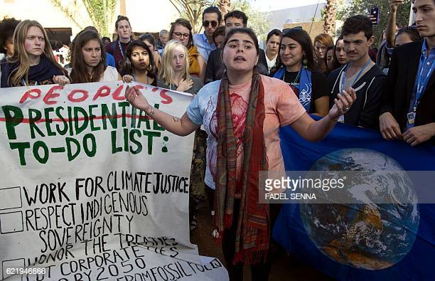 American students protest outside the UN climate talks during the COP22 international climate conference in Marrakesh in reaction to Donald Trump's...