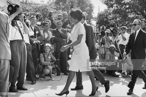 American students Vivian Malone and James Hood walk through the crowds as they become the first African American students to enrol at the University...