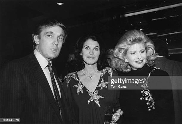American studio executive and former actress Sherry Lansing poses with businessman Donald Trump and his wife Ivana at Trump Towers in New York City...