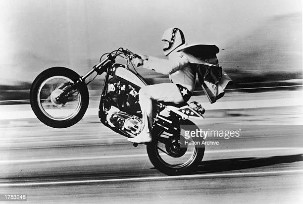 American stunt performer Evel Knieval pulls a 'wheelie' with his motorcycle 1970s