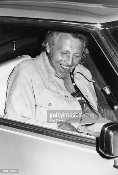 American stunt person Evel Knievel leaves London Airport after his arrival from the USA 1975