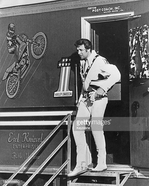 American stunt person Evel Knievel stands in the doorway of his official custom built coach he uses for touring circa 1972