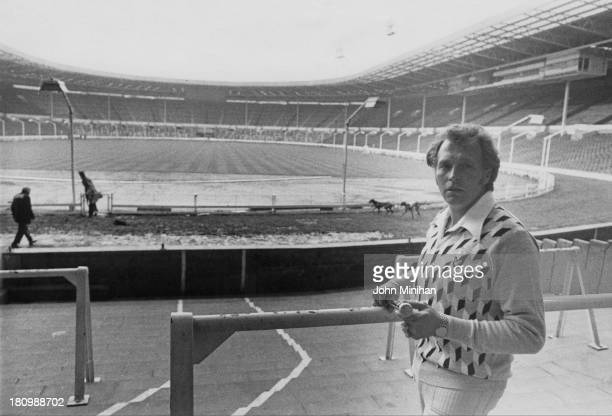 American stunt person Evel Knievel visits Wembley Stadium in preparation for his upcoming attempt to jump thirteen buses inside the stadium London...