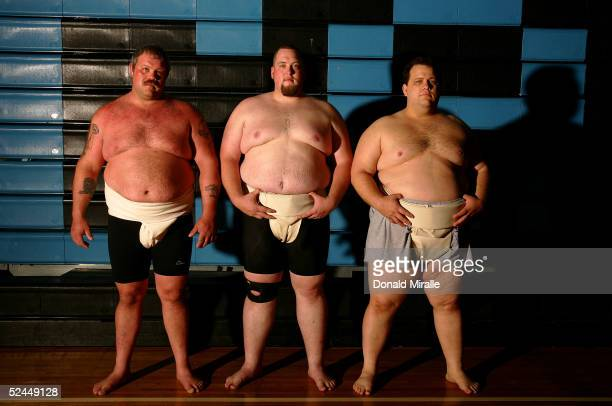 American Sumo wrestlers Carl P Pappalardo Scott Edwards and Kelly Gneiting pose before wrestling during a training and demonstration session for the...