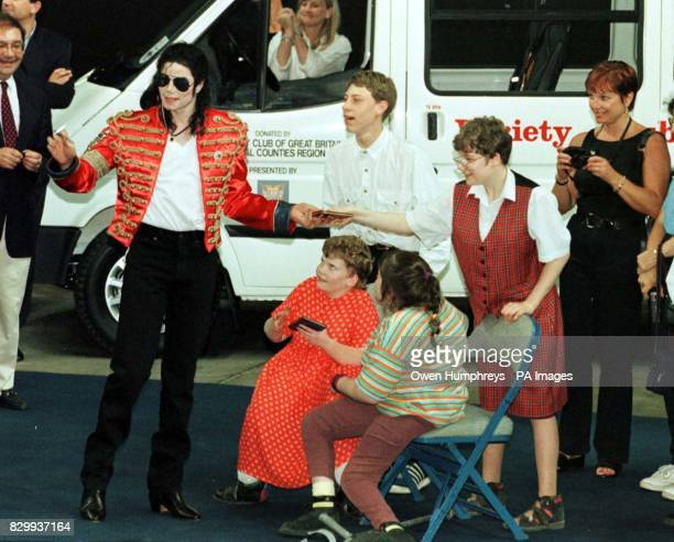 American super star Michael Jackson pictured during the handing over of Sunshine Coaches on behalf of the Variety Club of Great Britain his wife...