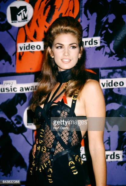 American supermodel Cindy Crawford wearing outfit by Versace attends the Ninth Annual MTV Video Music Awards on September 9 1992 at UCLA's Pauley...