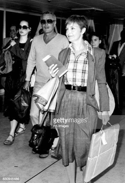 American superstar Paul Newman with his actress wife, Joanne Woodward and their daughters, Nell and Clea at London's Heathrow Airport.