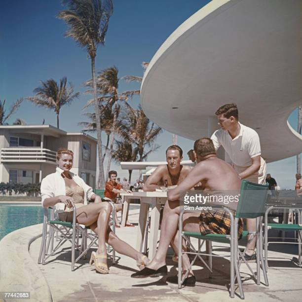 American swimmer and actress Esther Williams by the pool with friends in Florida 1955