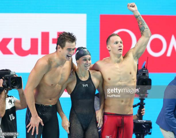 American swimmer Caeleb Dressel celebrates winning in his third gold medal of the evening with American teammates Mallory Comerford and Nathan Adrian...