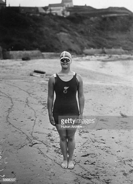 American swimmer Gertrude Caroline Ederle the first woman to swim the English Channel poses on the beach England August 6th 1926