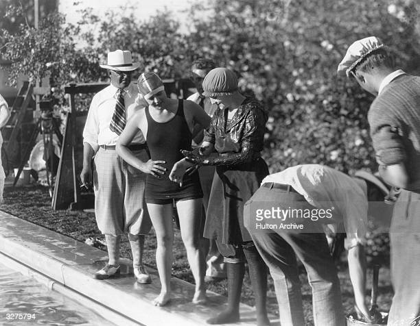 American swimmer Gertrude Ederle the first woman to swim the English Channel supervises actor Bebe Daniels who is smeared with grease for her part in...