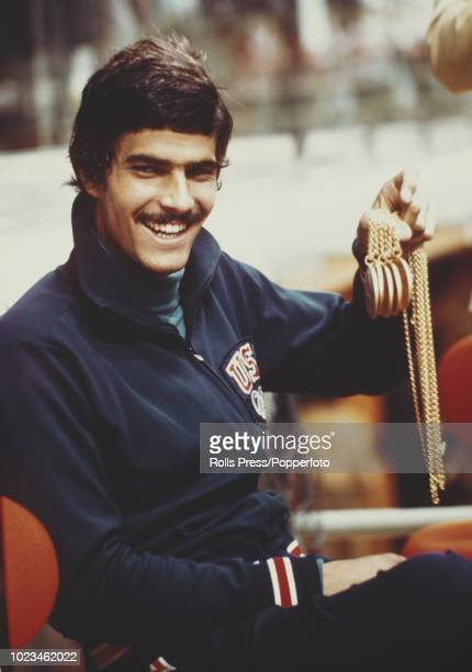 American swimmer Mark Spitz of the United States team holds five of his gold medals won in swimming events at the 1972 Summer Olympics in Munich...