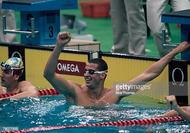 American swimmer Matt Biondi celebrates after finishing in first place to win the gold medal for United States in the Men's 100m freestyle event at...