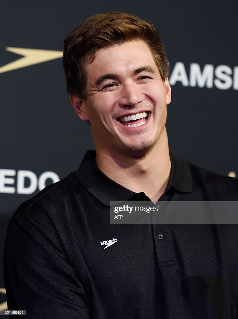 American swimmer Nathan Adrian laughs as he answers questions from