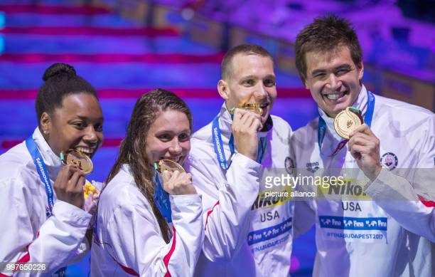 American swimmers Simone Manuel , Mallory Comerford, Caeleb Dressel and Nathan Adrian celebrate their world record-setting victory in the mixed 4 x...