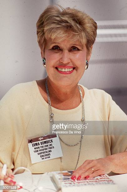 American syndicated columnist Erma Bombeck smiling at a signing for her book, 'When You Look Like Your Passport Photo, It's Time To Go Home'.