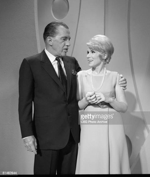 American talk show host Ed Sullivan puts his arm around American comedienne Joan Rivers as they chat on 'The Ed Sullivan Show' New York New York...