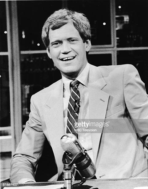 American talkshow host and comedian David Letterman sits at his desk on the television series 'Late Night with David Letterman' New York New York 1986