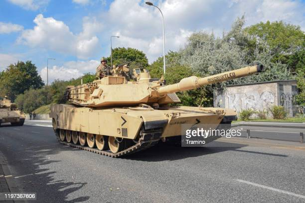 american tank abrams driving on a street - m1 abrams stock pictures, royalty-free photos & images