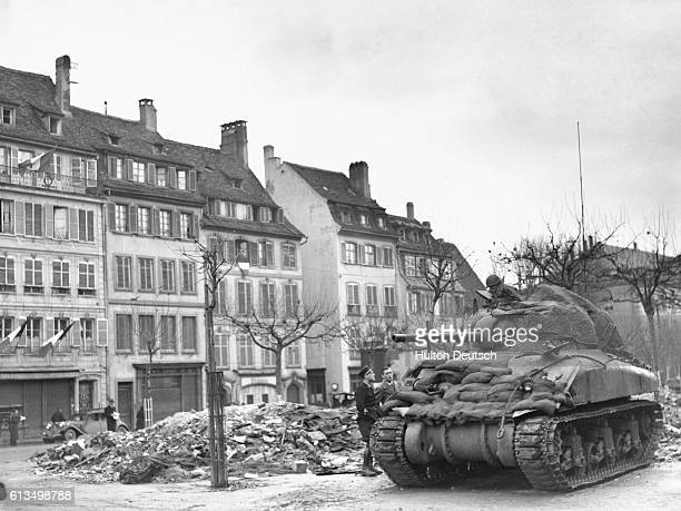American tanks arrive in the Nazinamed Adolf Hitler Platz in Strasbourg following the liberation of the city from four years of German occupation...
