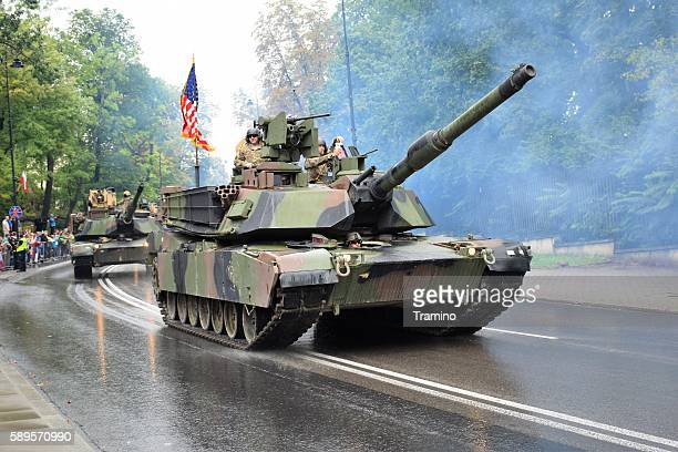 american tanks driving on the street - armored tank stock photos and pictures