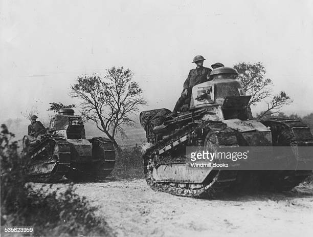 American tanks going forward to the battle line in Forest of Argonne. , 1918.