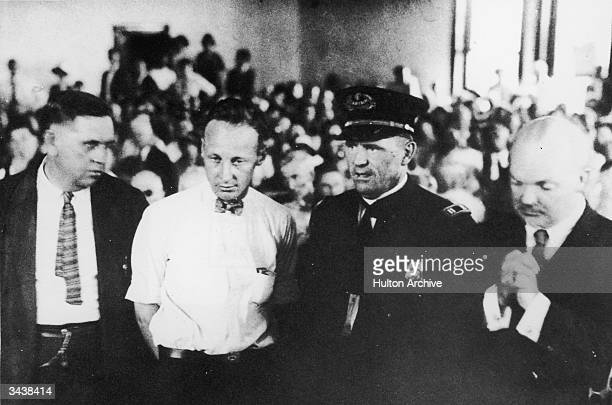 American teacher John Thomas Scopes standing in the courtroom during his trial for teaching Darwin's Theory of Evolution in his high school science...