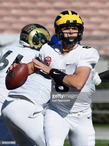 American Team quarterback John O'Korn from the Michigan Wolverines passes the ball against the National Team on January 20 during the second quarter...