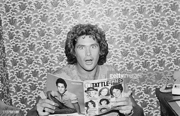 American television actor David Hasselhoff looks surprised as he poses with a copy of 'TattleTales' magazine in New York 1981 Hasselhoff is well...