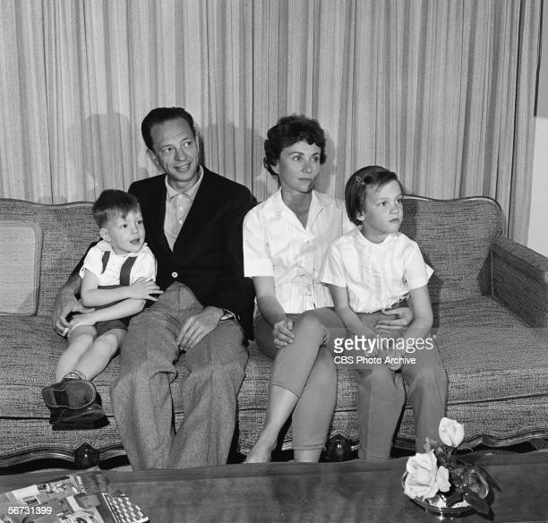 American television actor Don Knotts sits on a couch with his family at home March 2 1961 From left son Tom Knotts wife Kay and daughter Karen
