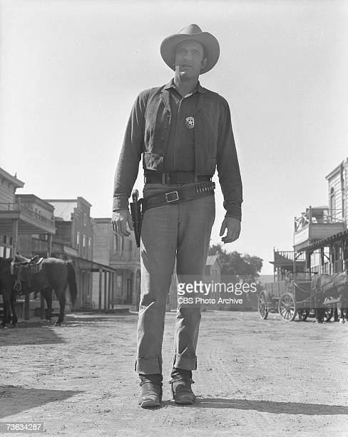 American television actor James Arness born James Aurness walks down the street in character as Marshall Matt Dillon in an episode of the CBS Western...