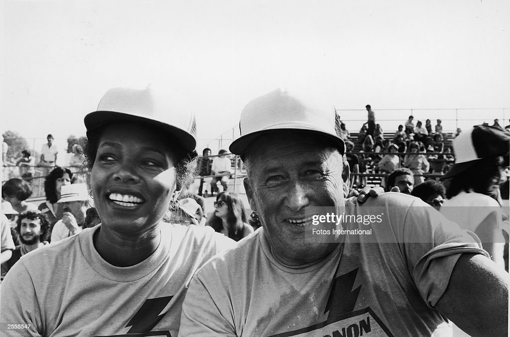 American television actor Lee Chamberlain has her arm around the shoulders of writer Mickey Spillane at the television competition, 'Battle Of The Network Stars VII,' October 1979.